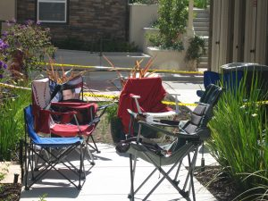 Camping chairs in front of the Parkwood sales office