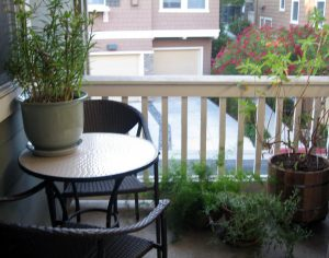 Bistro table and decorative plants on our center balcony - yes, two balconies making for great outdoor space.